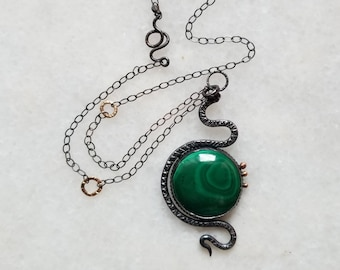 Unique oxidized sterling silver serpent holding a malachite, necklace with gold accents,  one of a kind snake pendant