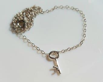Sterling silver tiny key pendant
