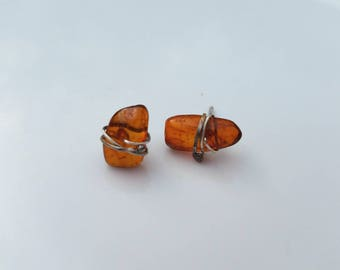 Drops of an ancient forest amber and sterling silver studs
