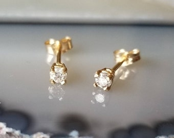 Sweet 14k gold 2.5mm diamond studs  earrings.