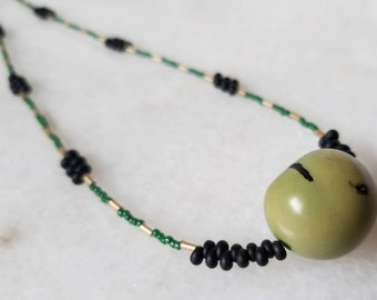 Long, organic large green tagua seed and Japanese micro bead layering necklace