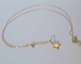 Tiny twinkling star 14k gold and  diamond necklace