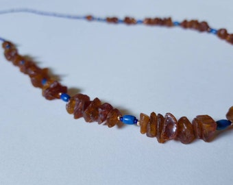 Long beaded asymetrical necklace with Baltic amber chips and lapis lazuli beads