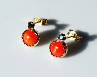 Intriguing ladybugs coral and black diamond 14k gold stud earrings.