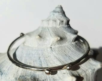 Heavy sterling silver orbit stacking bangle