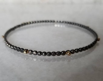 Black and gold hammered dot sterling silver stacking bangle