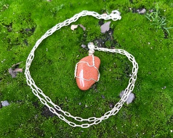 Jera's goldstone wire wrapped pendant
