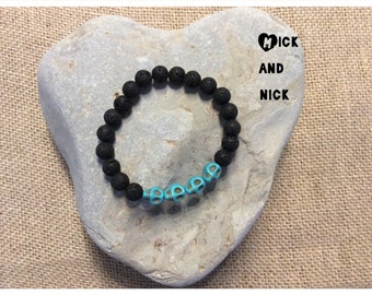 Aromatherapy lava bead diffuser bracelet for essential oils- 8mm black lava beads and turquoise skulls