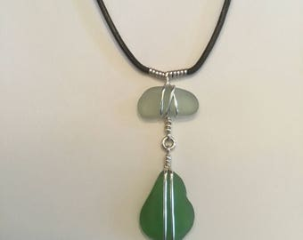 Genuine Seaglass and sterling silver necklace on black leather cord. Green and white glass.