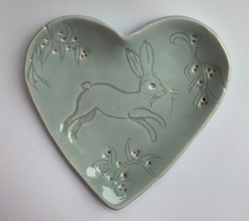 leaves and blossom features carved hare blue porcelain heart shaped ring tray Hare heart shaped trinket dish