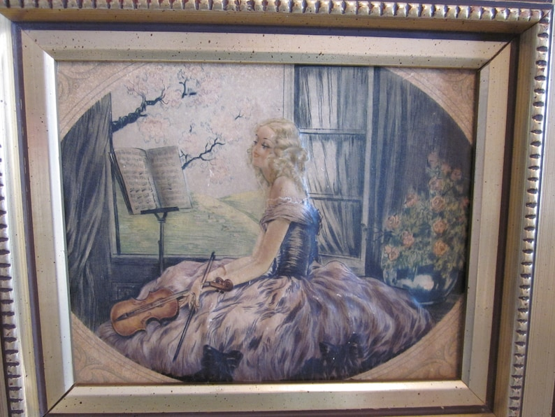 Old frame with raised effect  Technique made of plaster  Young woman with violin