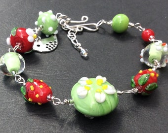 Strawberry and floral glass lamp work beaded bracelet