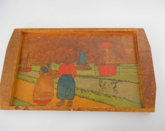 Wood engraved tray with a Dutch scene
