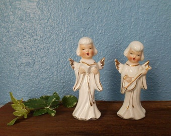Japan white and gold singing angels