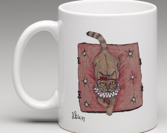 Cat mug sitting on a cushion (free delivery)
