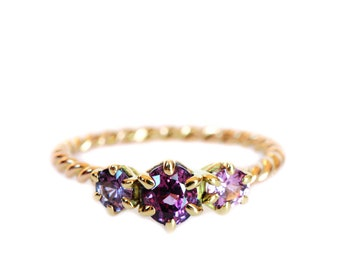 One off pink sapphire trilogy ring  18ct yellow gold