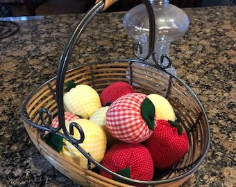 Basket of handmade fabric apples