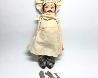 The Glass Kitchen Doll
