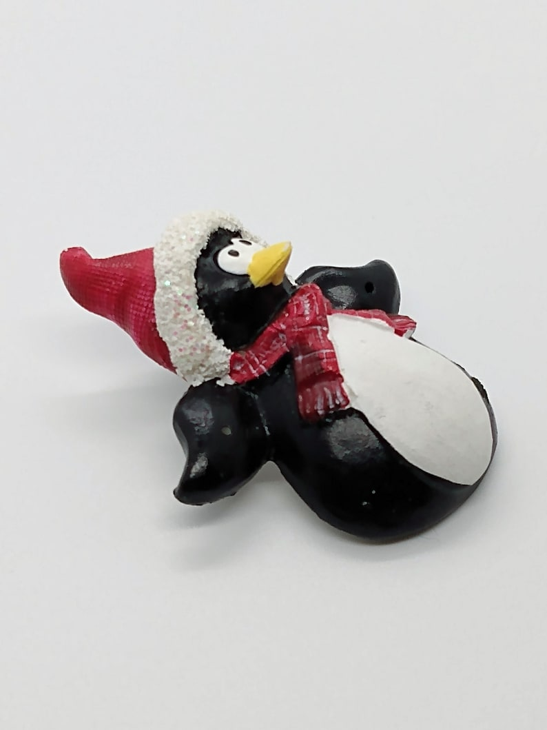 Vintage black and white cartoon penguin in red scarf /& red and glittery white Santa hat brooch pin ; about 2 x 1 12 in.