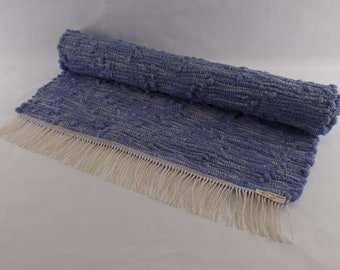 Twilight, a handwoven rag rug, hand dyed and made especially for you. This rug is color/fast, wash/fast, and machine washable.