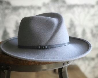 Wallace:  Unisex Cross front Trilby crown with asymmetrical brim.  Size 22 1/2""