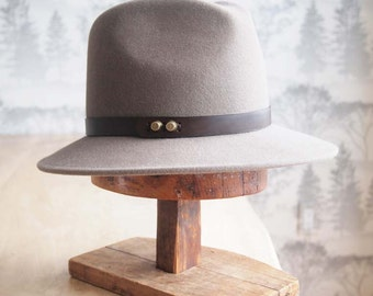 "Claude I:   Men's weight Felt Fedora with matching 3/4"" leather trim with antique brass studs"