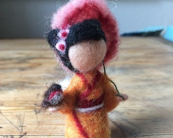 Child needle-felted East Asia with small bird for mobile or seasonal table