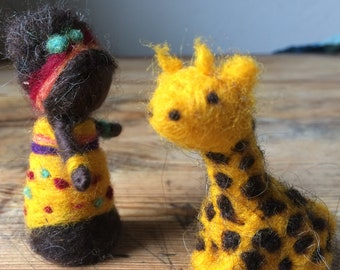 Child needle-felted Central Africa with small giraffe for mobile or seasonal table