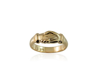 """From the """"Two Gather"""" trilogy - """"To Hold"""" - Contemporary claddagh, fede ring in 9 carat and 18 carat white, yellow and rose gold"""