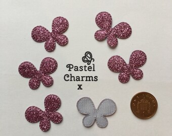 Pack of 10 purple glitter butterfly embellishments