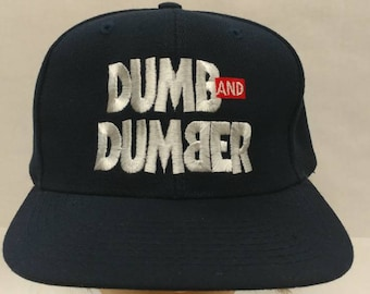 1ec0e87dd1829 Vtg 90s Deadstock Dumb   Dumber Movie Promo hat Otto brand