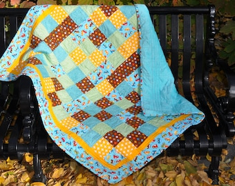 Aqua, yellow, blue, green, and brown baby boy patchwork quilt