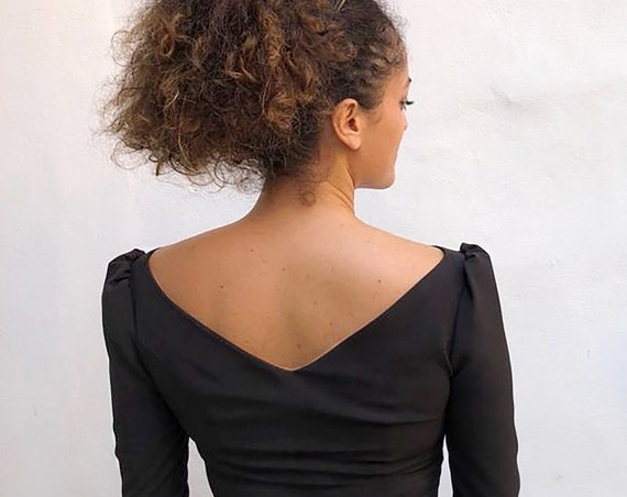 BLACK fitted PARTY TOP for women with 3/4 puff sleeve, boat neck and v neckline on the back, a bit stretched