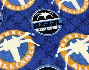 Fabric by the Yard - GLOW in the DARK Star Wars Rebel Alliance on Blue