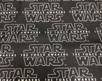 Fabric by the Yard - Star Wars Force Awakens Logo on Black
