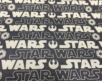 Fabric by the Yard - Star Wars Gray and Charcoal Logo
