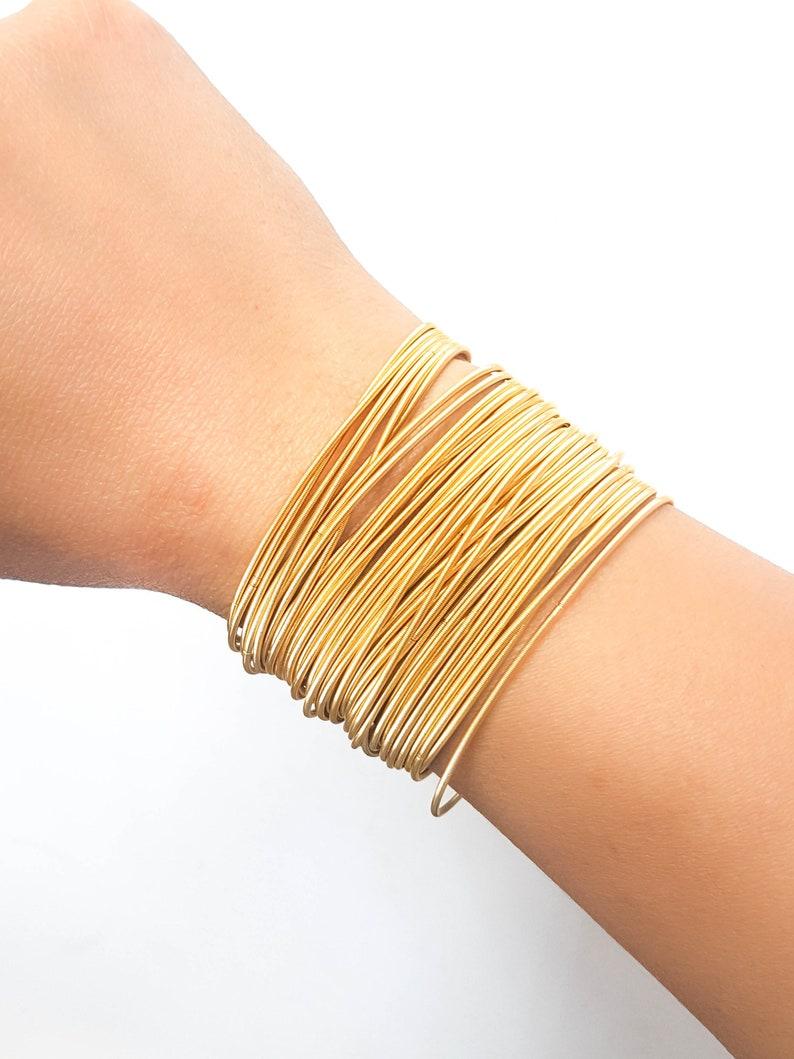 c10228999c6 SALE Gold guitar string bracelets silver spring bracelets   Etsy