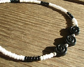 10 quot Black and White Stretch Anklet featuring Three Swirl Black Glass Coin Beads