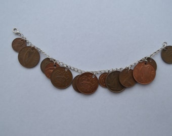 Foreign coin charm bracelet
