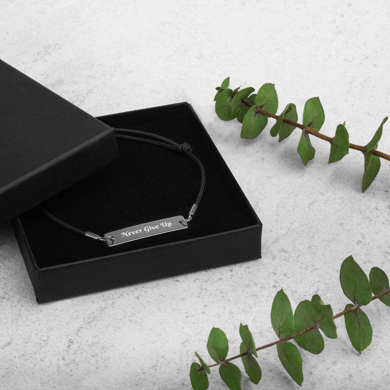 Never Give Up Inspirational Engraved Silver Bar String image 0