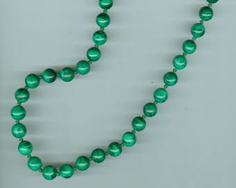 """Necklace, beaded, East African. Green figured malachite, round beads (10 mm), strung on cord with decorated silver clasp. L: 26""""."""