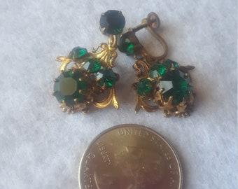 Vintage Jecho screw back earrings with emerald like stones.