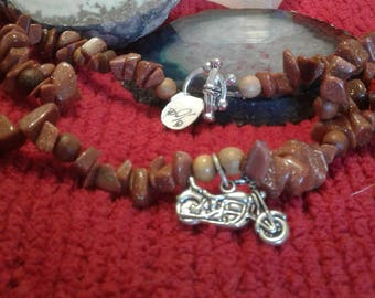 Motorcycle with Goldstone necklace