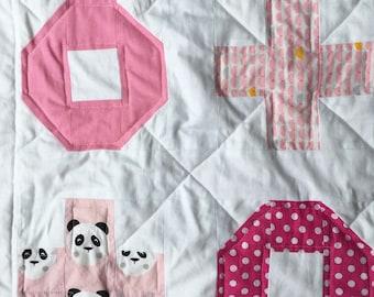 Noughts & Crosses Pink Cot Quilt