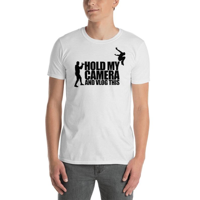 Hold My Camera and Vlog This  Short-Sleeve Unisex T-Shirt image 0