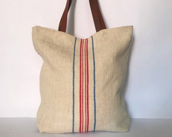 Vintage grainsack linen tote with red and blue stripes.