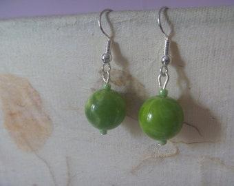 handmade spherical green earrings