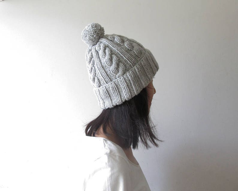 d3160b33a8c Cable Knit Hat in Light Grey Melange Gray Womens Pom Pom hat