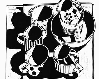 Black and white lino print of decorative dotty cups and shadows