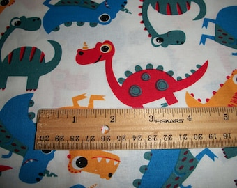 75afbfa4e5 Taie d'oreiller en taille enfant coton couleurs primaires Dinos